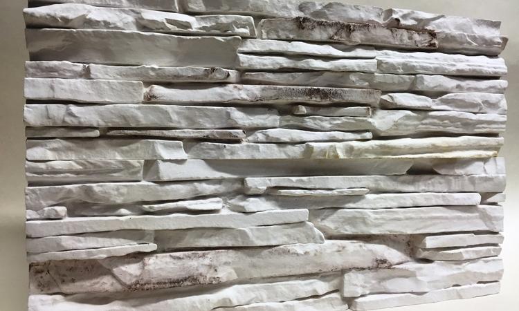Akmens sienas dizains